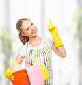Happy young housewife in glove Royalty Free Stock Photo