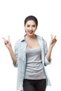 Happy young japanese girl showing victory sign isolated on blue background. Royalty Free Stock Photo