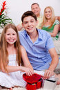 Happy young kids with gift boxes in living room Stock Photos