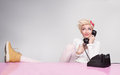 Happy young lady having conversation with her boyfriend on the phone Royalty Free Stock Image