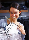 Happy young lady purchasing clothes in store Stock Images