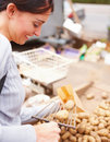 Happy young lady shopping potatoes in a store Stock Images