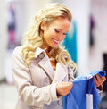 Happy young lady with a sweet smile shopping Stock Images