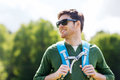 Happy young man with backpack hiking outdoors Royalty Free Stock Photo