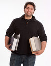 Happy young man with books Royalty Free Stock Photo