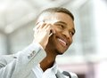 Happy young man calling by mobile phone Royalty Free Stock Photo