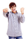 Happy young man with car keys screaming student and raised fist isolated on white background mask included Royalty Free Stock Images