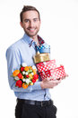 Happy young man with flowers a gift portrait of and isolated on white Royalty Free Stock Image