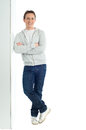 Happy young man full length portrait of with arm crossed standing over white background Royalty Free Stock Image