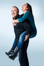 Happy young man giving a piggyback ride to her wife Stock Photo