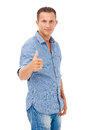 Happy young man giving you the thumbs up portrait of a over white background Royalty Free Stock Image