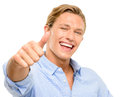 Happy young man holding thumbs up isolated on white background smiling Royalty Free Stock Photography