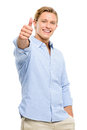 Happy young man holding thumbs up isolated on white background smiling Royalty Free Stock Images