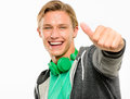 Happy young man holding thumbs up smiling isolated on white back with headphones Royalty Free Stock Images