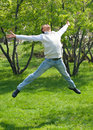 Happy young man jumping in air Royalty Free Stock Photo