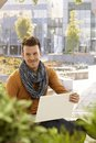 Happy young man with laptop outdoors Royalty Free Stock Photo