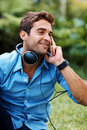 Happy young man listening to music on headphone Royalty Free Stock Photography