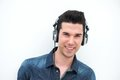 Happy young man listening to music and smiling portrait of a Royalty Free Stock Photo