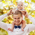 Happy young man men holding a smiling months old baby Royalty Free Stock Photo