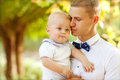 Happy young man men holding a smiling months old baby Royalty Free Stock Photography