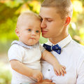 Happy young man men holding a smiling months old baby Stock Photography