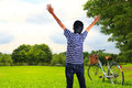 Happy young man in the park and bicycles Stock Photo