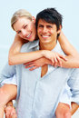 Happy young man piggybacking girlfriend Royalty Free Stock Photo