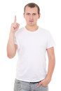 Happy young man pointing upwards over white background isolated on Royalty Free Stock Photos