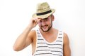 Happy young man posing against white background with hat Royalty Free Stock Photo