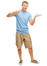 Happy young man showing empty copyspace on white background copy space Royalty Free Stock Photos