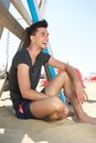 Happy young man sitting at the beach portrait of a Royalty Free Stock Images