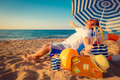 Happy young man sitting on the beach Royalty Free Stock Photo