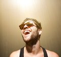 Happy young man smiling with sunglasses Royalty Free Stock Photo