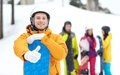 Happy young man with snowboard showing thumbs up winter leisure extreme sport friendship and people concept men in helmet and Royalty Free Stock Photo