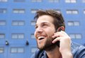 Happy young man talking on mobile phone close up portrait of a Royalty Free Stock Photo