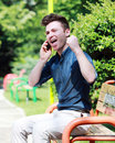 Happy young man on telephone Royalty Free Stock Photos