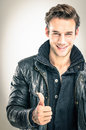 Happy young man thumbs up gesture with Royalty Free Stock Photography