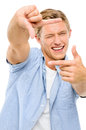 Happy young man thumbs up isolated on white background framing a photograph Royalty Free Stock Images