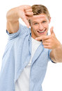 Happy young man thumbs up isolated on white background framing photograph using fingers Stock Image