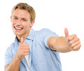 Happy young man thumbs up isolated on white background showing sign smiling Stock Photography