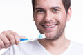 Happy young man with a toothbrush сlose up portrait of isolated on white Royalty Free Stock Photography
