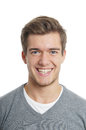 Happy young man with toothy smile Stock Image