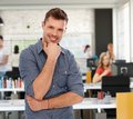 Happy young man at trendy youthful office casual men Stock Photos