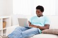 Happy young man using laptop Royalty Free Stock Photo