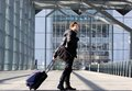 Happy young man walking with suitcase at station Royalty Free Stock Photo