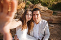 Happy young married couple making selfie at the beach Royalty Free Stock Photo