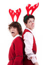 Happy young men wearing reindeer horns Stock Photography