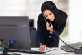 Happy young middle eastern businesswoman working office Royalty Free Stock Photos