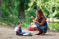 Happy young mother and adorable toddler girl walking through sum Royalty Free Stock Photo