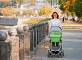 Happy young mother with baby in buggy Stock Photography